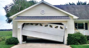 broken-damaged-garage-door-repair-replacement-adjustment-24-7